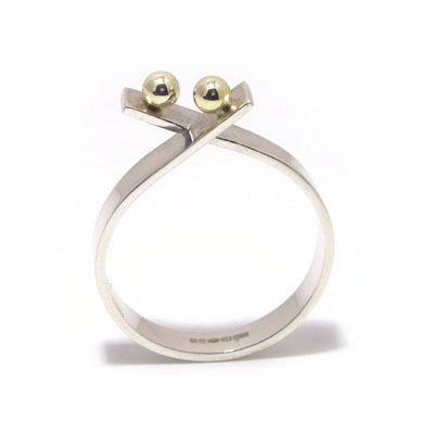 Double gold ball crossover ring