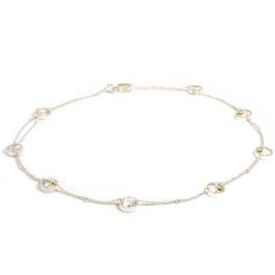 Multiple small open circle gold ball loop necklace
